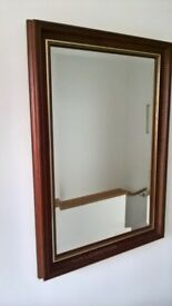 large bevelled mirrow in dark wood surround 545 mm W x 770 mm H Ii perfect condition
