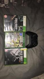 X box controller and 3 games