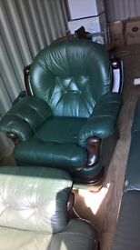 Two dark green leather chairs