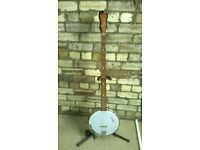 Seeger Banjo in good condition, with new strings, bridge, tuning pegs, strap & finger picks