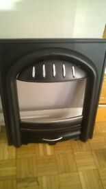 Black ornate looking fire surround