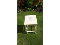 Small side table with Cherub stencil for added charm