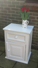 Old pot cupboard newly painted in a neutral colour.