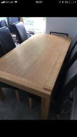 Solid oak dining table in excellent condition Size 1.8m x 1m worth £1000 new