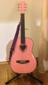 Children's pink acoustic guitar with case and stand