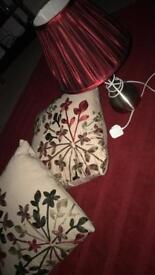 Silver and red lamp with 2 cushions from Dunelm