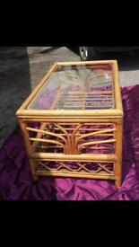 Wooden coffee table with glass top. £10.00