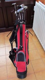 Mixed set of woods and clubs - includes Dunlop golf bag
