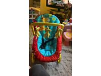 hardly used immaculate giraffe baby rocking seat