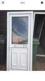 White used UPVC Front Door In Frame
