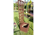 Rustic square wooden planter with trellis