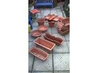selling as job lot selection of plastic garden planters (trays, pots troughs), no damage, some new