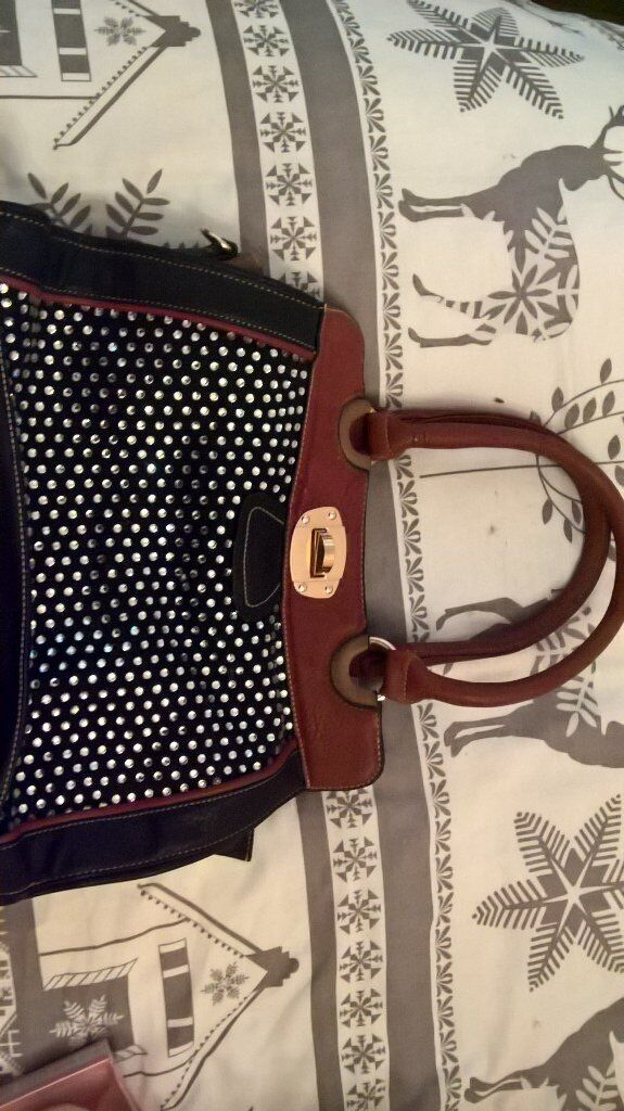 leather bagin Reading, BerkshireGumtree - £5 Lovely pure leather handbag Nice looking bag Studded. Used only once. Collection Whitley wood Xxxxxxxxxxxxxxxxxx xxxxxxxxxcxx No offers