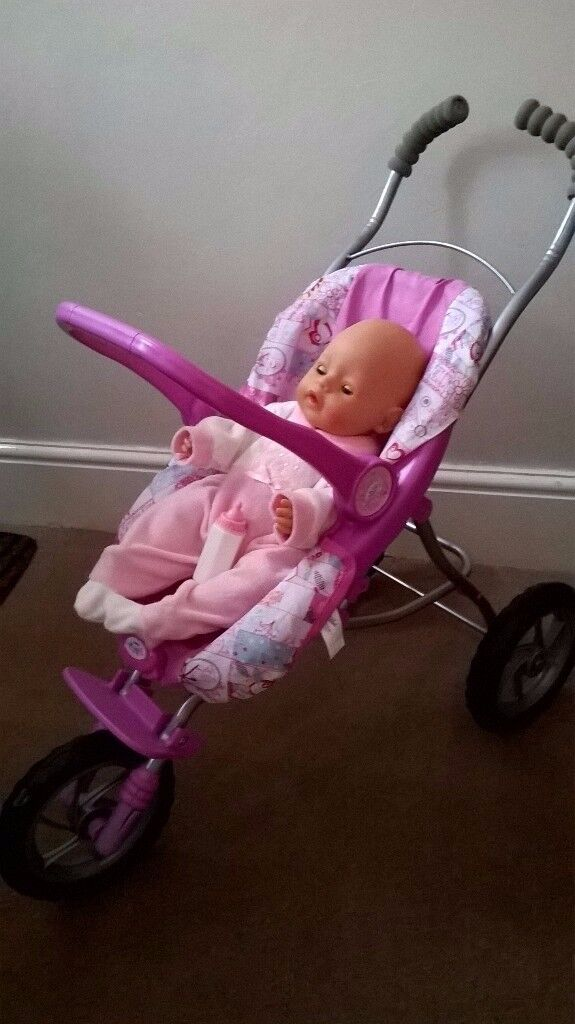 baby doll pushchair- three wheeler with a doll