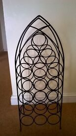 Attractive black metal frame 18 bottle wine rack. Collection only please.