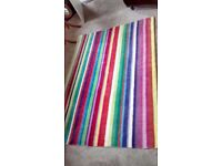 WOOL RAINBOW,CANDY STRIPED ,RUG MEASURES APPROX 120 CM X 171 CM.