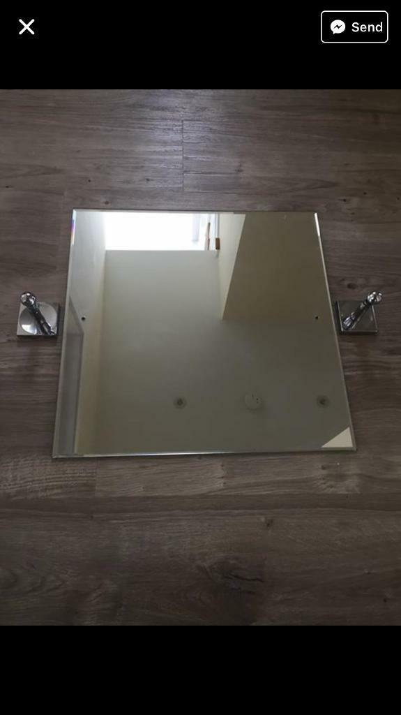 Swivel bathroom mirror with small crack in the corner