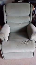 Free reclined green armchair