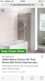 Pivet shower screen with shelves and towel rail