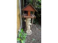 garden bird feeder , wooden top on a concrete stand