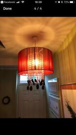 Two red lampshade/chandeliers