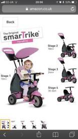 Smart Trike 4 in 1 kids tricycle in pink