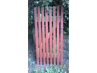 Well made wooden garden gate with hinges and latch locck