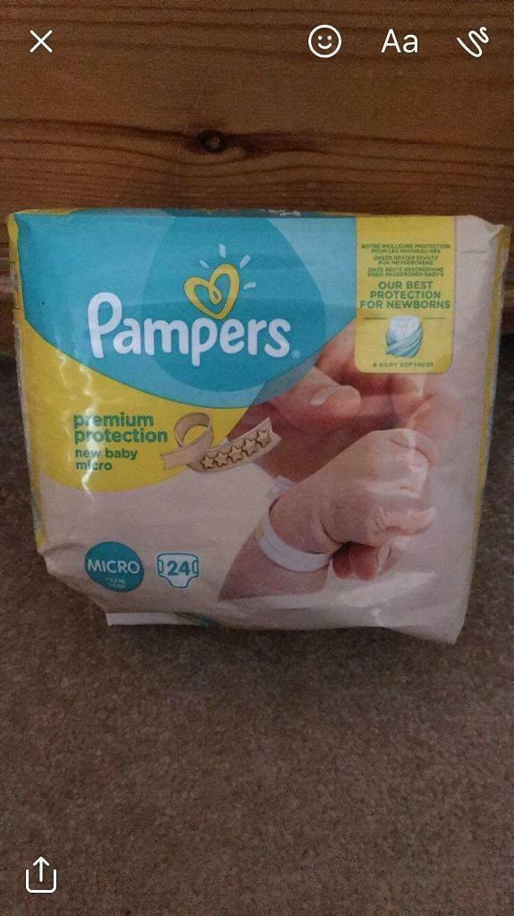 6 packets of micro baby nappies