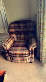 Selection of armchairs and sofas for sale.