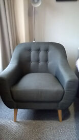 Retro charcoal grey armchair, nearly new, in perfect condition.