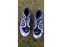 Nike Silver Bowerman sprinting shoes and bag.
