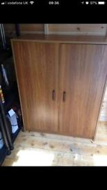 Wooden cabinet with doors and shelf
