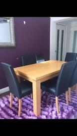 Light oak Dining table and six leather chairs
