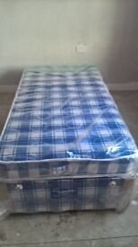 bed base and mattress brand new base still has plastic on it