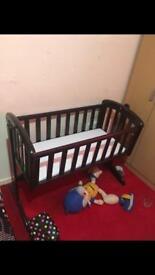 Dark brown swinging crib