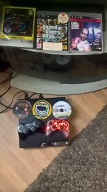 PlayStation 3, fully working condition with 2 controllers and 6 games for sale