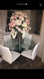 Glass dining table with 4 cream chairs