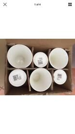 18 white vases