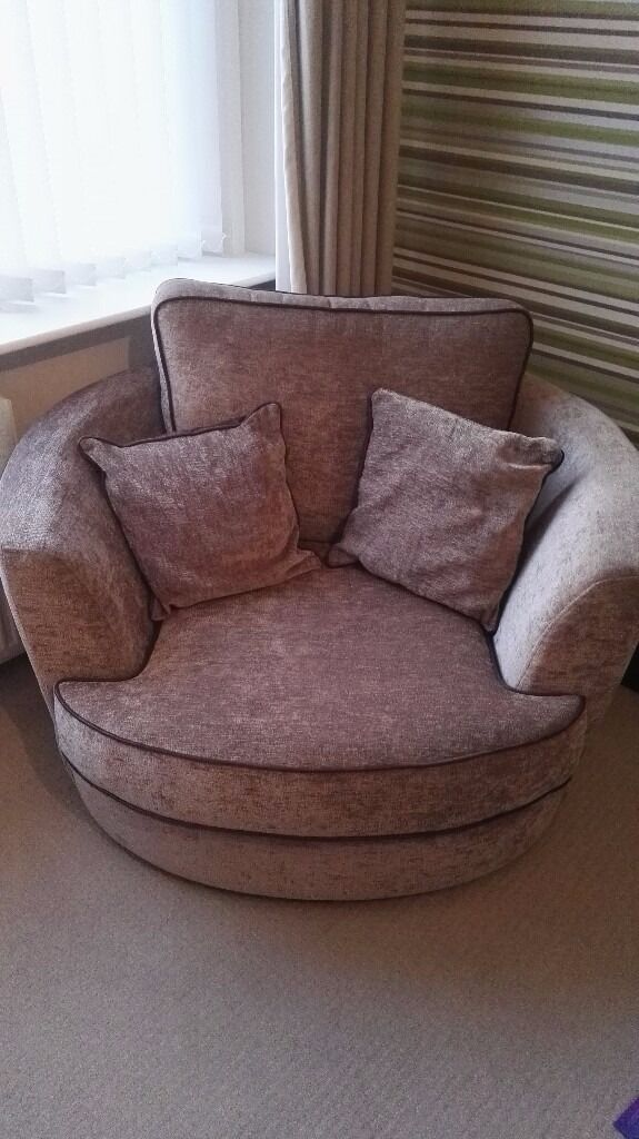 Corner sofa with snuggle chair and matching foot stoolin Kintore, AberdeenshireGumtree - Corner sofa with matching snuggle chair and footstool. Light brown fabric with leather effect arms. In excellent condition.selling due to house move.Corner sofa can be taken apart for transporting. Ex buick of montrose. Buyer to collect. £650