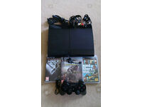 PS3 Super Slim 500GB Charcoal black console plus 3 of the main games and headset