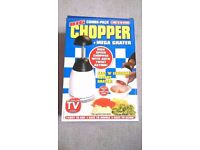 Unused, brand new big combo-pack chopper and mega grater!