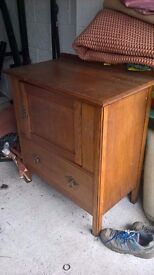 Solid Oak small cabinet with door and drawer.