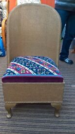 Lloyd loom style bedroom chair with tapestry seat.