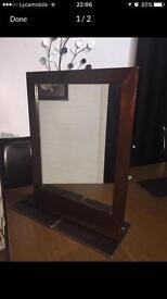 Brown wooden frame mirror