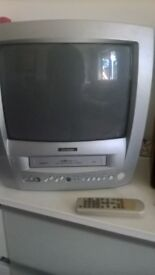 Television with VHS reader and recorder