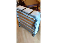 Folding bed with clean mattress