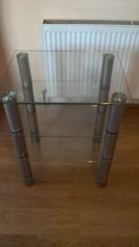Four tiered glass tv stand / shelving unit