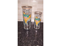 One pint and half pint lager glasses