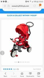 Red 3 in 1 trike. Like new used twice