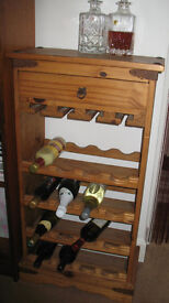 Rustic unpolished pine 16-bottle wine rack with stem glass storage slots